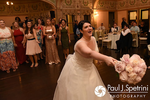 Allison tosses her bouquet during her September 2017 wedding reception at the Roger Williams Park Casino in Providence, Rhode Island.