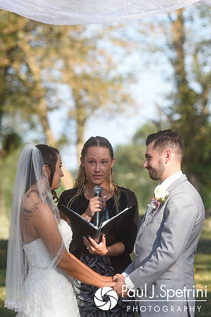 Stacey and John look at each other during their September 2017 wedding ceremony at Colt State Park in Bristol, Rhode Island.