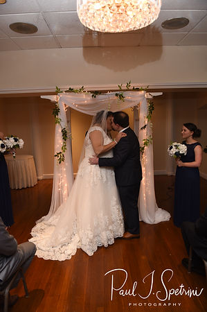 Gunnar and Aileen kiss during their December 2018 wedding ceremony at McGoverns on the Water in Fall River, Massachusetts.