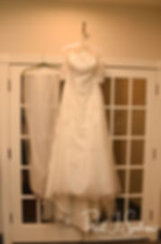 Cara's dress hangs on display during her bridal prep session at the Aqua Blue Hotel in Narragansett, Rhode Island prior to her November 2018 wedding.