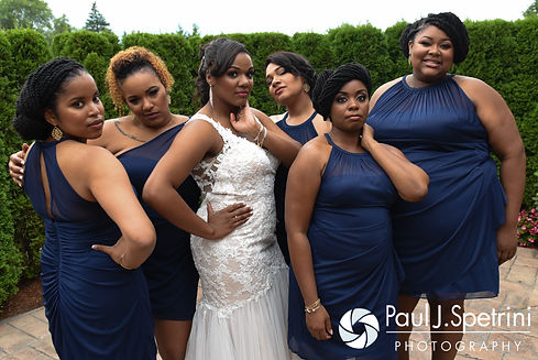 Kemi and her bridesmaids pose for a photo prior to her August 2016 wedding reception at the Villa at Riddler Country Club in East Bridgewater, Massachusetts.