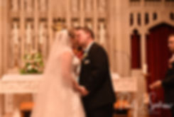 Courtney and Patrick have their first kiss during their September2018 wedding ceremony at St. Paul Church in Cranston, Rhode Island.