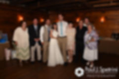 Krystal and Ian pose with family members for a photo during their May 2016 wedding reception at DeWolf Tavern in Bristol, Rhode Island.