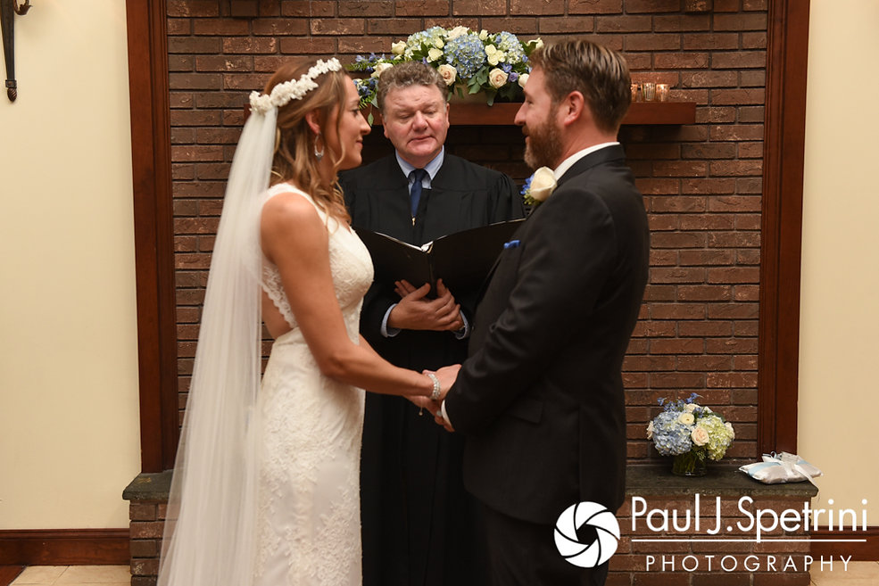 Kevin and Joanna hold hands during their October 2017 wedding ceremony at Cranston Country Club in Cranston, Rhode Island.