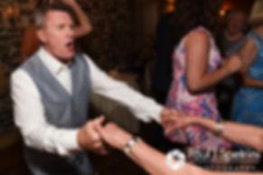 Guests dance during Bob and Debbie's June 2016 wedding reception at DeWolf Tavern in Bristol, Rhode Island.