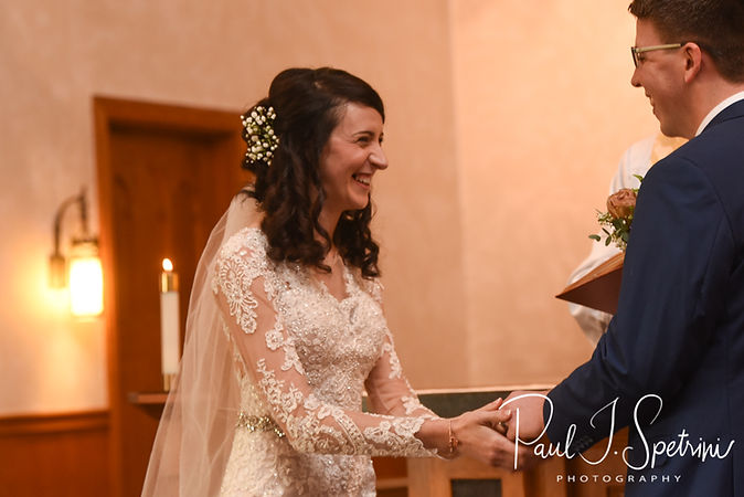 Stacey laughs during her December 2018 wedding ceremony at St. Teresa's Church in Attleboro, Massachusetts.