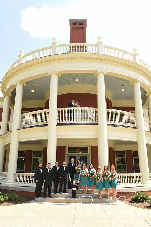 Danielle and Mark pose for a photo with their wedding party following their August 2018 wedding ceremony at the Roger Williams Park Casino in Providence, Rhode Island.