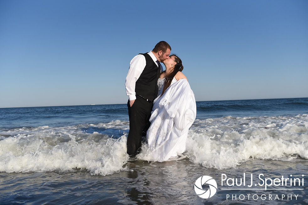 Clarissa and Jeff kiss in the water during a July 2017 'Trash the Dress' photo shoot at Black Point Trailhead in Narragansett, Rhode Island.