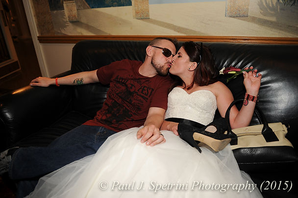 Justin and Jamie Bolani kiss at the end of their June Wedding in Rhode Island.