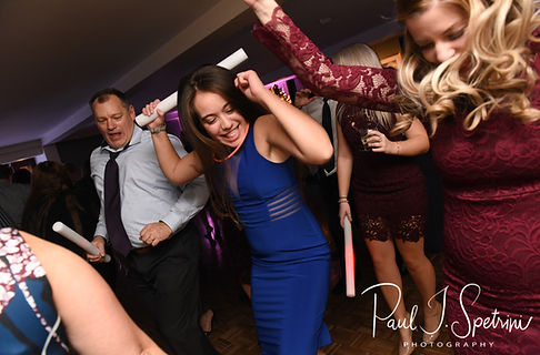 Guests dance during Stacey & Mack's December 2018 wedding reception at Independence Harbor in Assonet, Massachusetts.