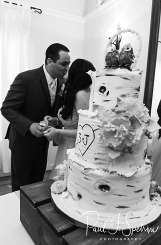 Jacob and Stephanie cut their cake during their June 2018 wedding reception at Foster Country Club in Foster, Rhode Island.