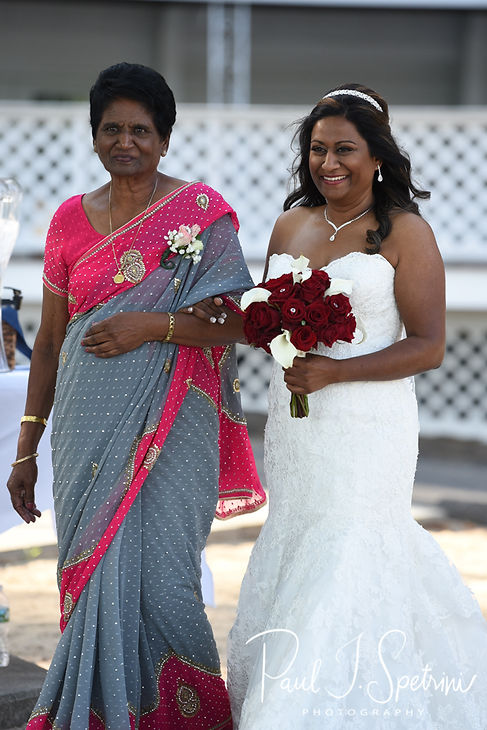 Saken walks down the aisle with her mother during her July 2018 wedding ceremony at Lake Pearl in Wrentham, Massachusetts.