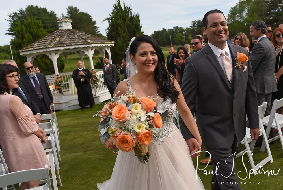 Stephanie and Jacob walk down the aisle during their June 2018 wedding ceremony at Foster Country Club in Foster, Rhode Island.