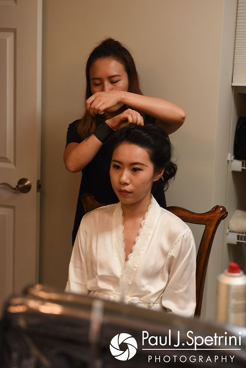 Cynthia has her hair done prior to her August 2017 wedding ceremony at Lake Pearl in Wrentham, Massachusetts.