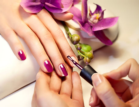 Manicure nail paint pink color.jpg
