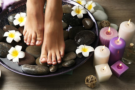 Female feet at spa pedicure procedure.jp