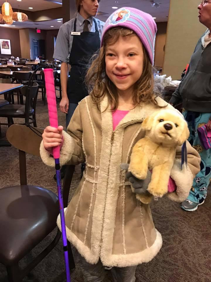 PD: This is a photo of our friend Hallie. Kristin gave her a new pink and purple cane a few years ago that she named bubbles. She is also holding a seeing eye stuffed animal.