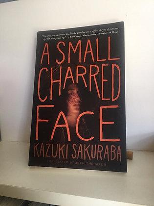 A Small Charred Face (1) Paperback – September 19, 2017 by Kazuki Sakuraba (Auth