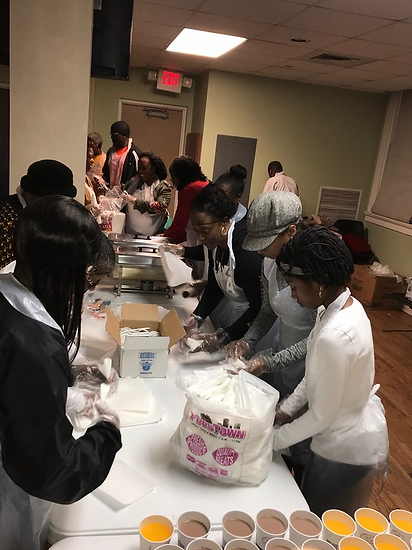 Youth Achievers Serving at Bread of Life Founder's Day Weekend.png