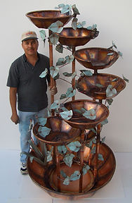 this is roberto standing next to his 7 bowl water fountain