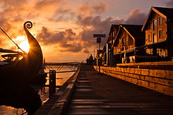 Seafront on the sunset with Viking ship.