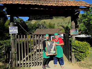 Owners of a famous local restaurant in Três Picos Park putting our poster on their wall.