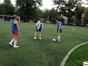 Ariel teaching adults how to play soccer, and better their soccer skills