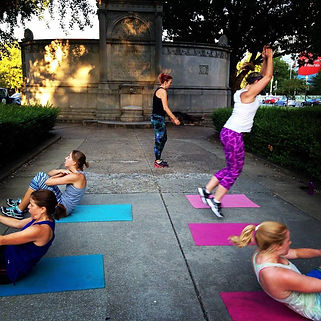 Jumping, sit ups, and cardio at bootcamp class