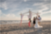 Photo by Treasured Moments Photography of Wedding on beach officiated by Donna Brown.