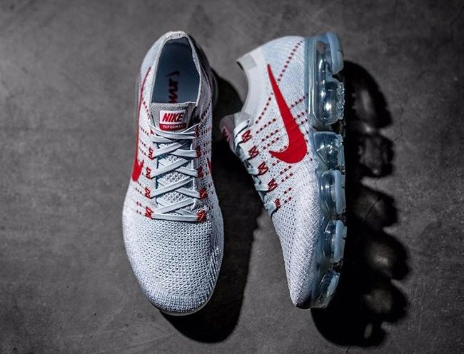 red and white Nike Vapor Max