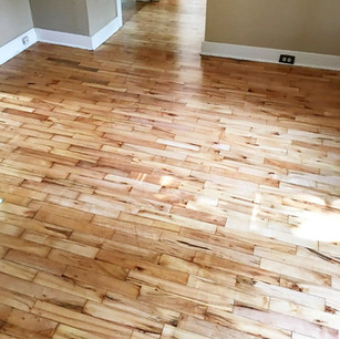 Refinished 40 year old wood floors with a clear natural coat