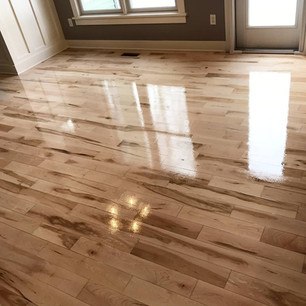 Hickory wood floor Refinishing with a shiny clear coat in a home in Grand Rapids, Michigan
