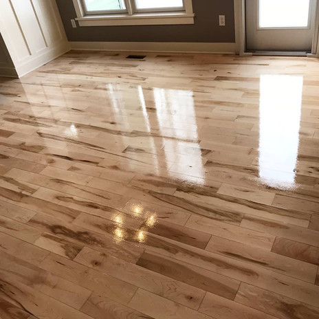 Newly installed custom wood flooring in a sunroom