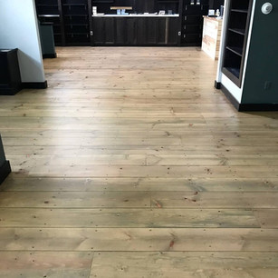 Refinished Commercial Pine wood floor in a kitchen