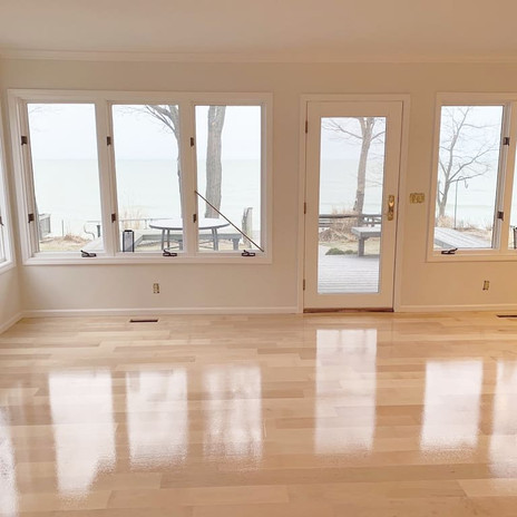 Installed maple wood floors with a shiny coat