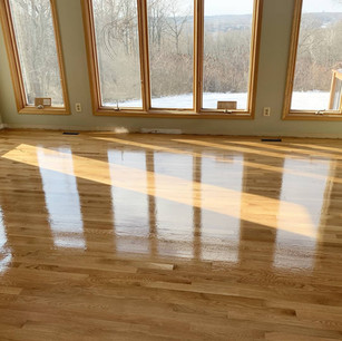 Refinished wood floor in sun room