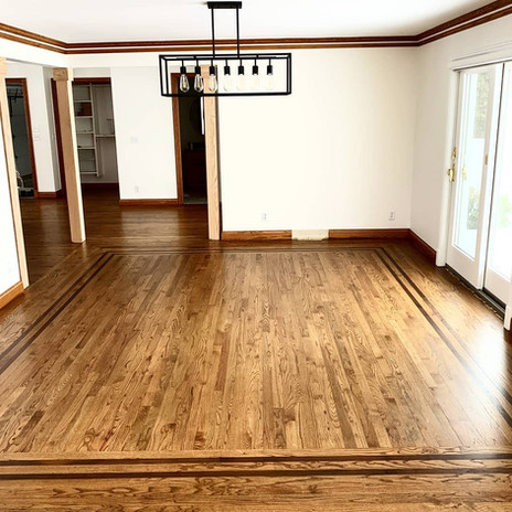 Refinished oak wood floors in dining room of old home