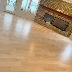 Maple wood floor installed in a diagonal pattern