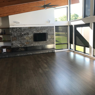 Installed dark wood floor in living room