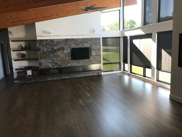 Dark plank wood floors installed in a living room