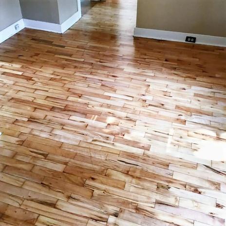 Beautiful 40-year-old custom refinished wood floors in Michigan home