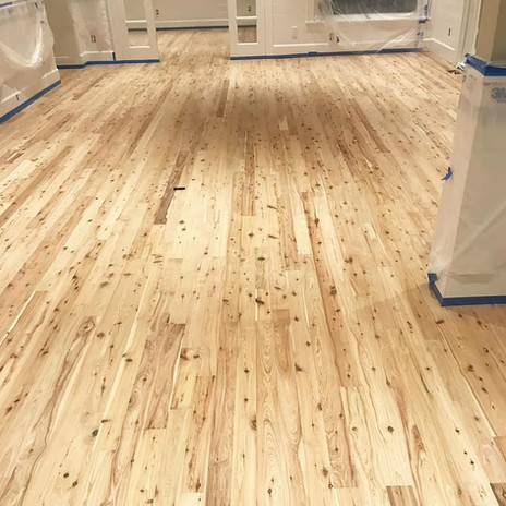 Refinished commercial pine wood floors in living room