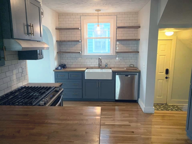 Refinished wood floor in kitchen