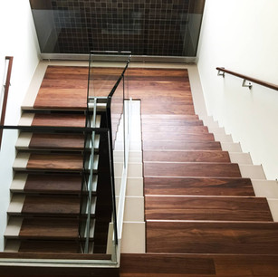 Staircase with newly installed wood floors