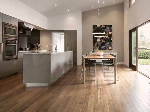 Modern wood floors installed in kitchen and dining room