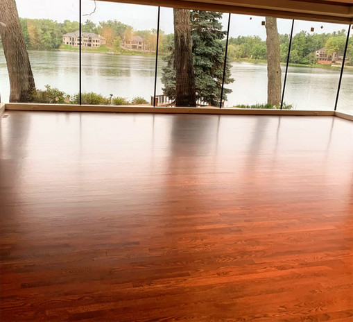 Red Cherry wood floors installed in sunroom of lakefront West Michigan home