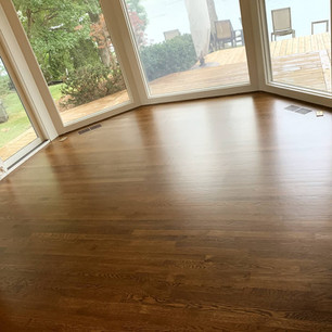 Oak wood floor refinished in a sun room
