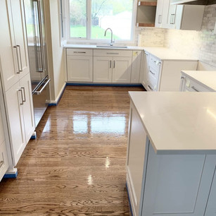 Oak flooring installation in a bright kitchen in East Grand Rapids, Michigan