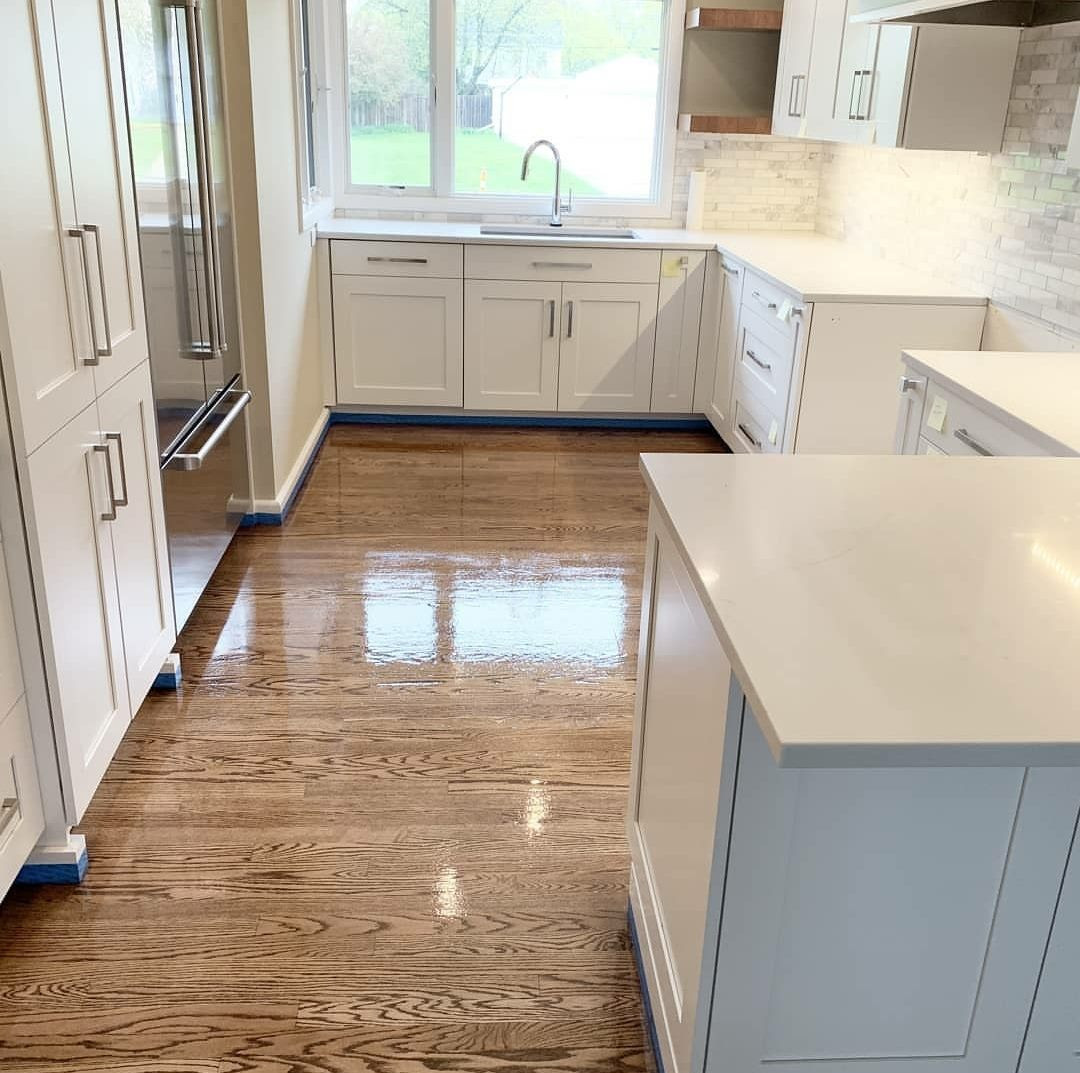 Refinished oak wood floors in a kitchen in East Grand Rapids, Michigan