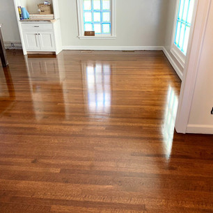 Refinished wood floor in living room